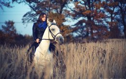 white hors and woman