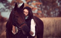 Brown hors and woman